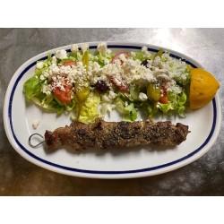 Pork skewers with Greek salad