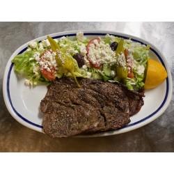 Rib steak with Greek salad